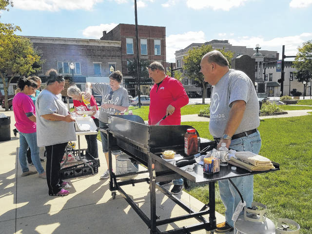 """Crossroads Christian Church members and volunteers gathered Friday afternoon to give the community a """"shout out"""" as a way to say thanks for the many services and goods offered by the businesses of Washington Court House. Crossroads took time to honor these businesses and employees by giving them a free meal on the Fayette County Courthouse lawn that they could eat there or take with them back to their work places."""