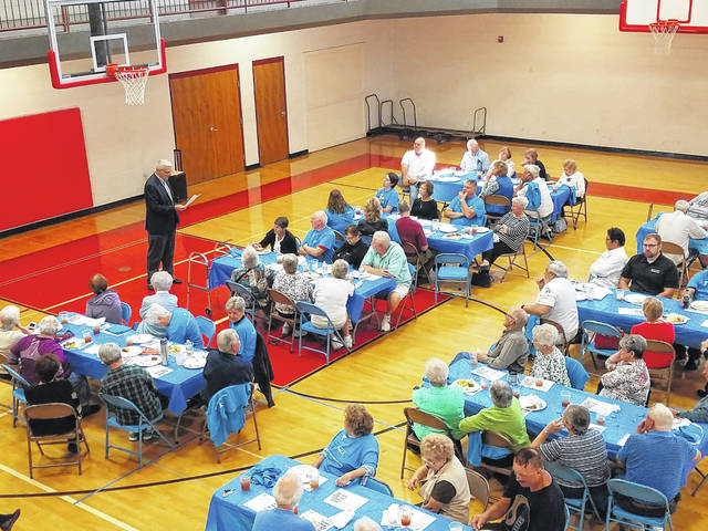Terry Feick, capital campaign chairman for the Fayette County Family YMCA, spoke to the crowd that had gathered to help celebrate its 10-year anniversary. To celebrate a decade of helping Fayette County families, the YMCA held a lunch and had several board members and employees talk about the journey to 10 years.