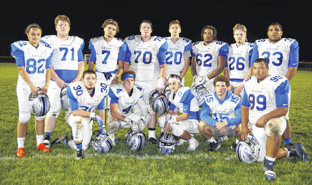 Washington Blue Lion seniors on the field at McClain High School Friday, Oct. 13, 2017. (front, l-r); Trenton Henize, Caleb Rice, Eli Ruth, Jacob Rice, Marcell Garrett; (back, l-r); Jaelyn Mason, Chandler Manning, Zane Nelson, Jacob VanMeter, Jordan Behm, Derrick Wade, Trystan Uhl and Adrian Butterbaugh. Washington defeated McClain, 48-10.