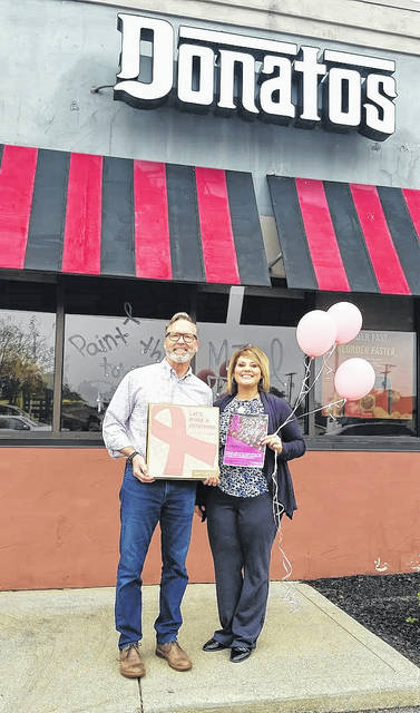 Doug DeVilbiss, Washington C.H. and Wilmington Donatos Pizza owner, and Chelsie Hornsby, Fayette County Memorial Hospital director of business development.
