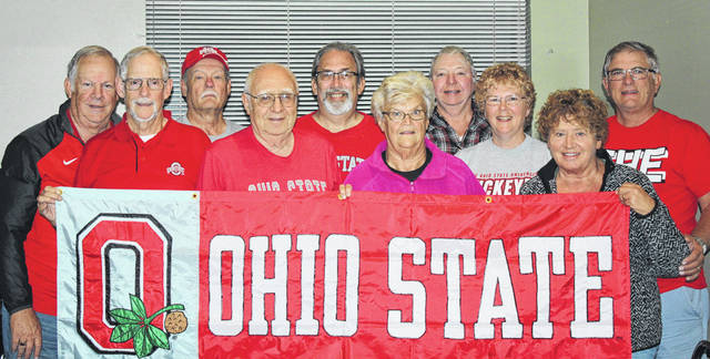 Members of the Jeffersonville and Washington C H Lions clubs met recently to plan for next month's Beat Michigan Tailgate Party. Pictured (L to R): Jay Carey, Terry Jackson, Kenny Blade, John Rhoad, Chris Bowshier, Marilyn Fannin, Jerry Spahr, Sue Willis, Sue Burnside, and Ray Deeks.