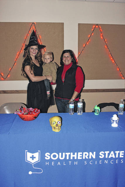 Lisa Mahan, Liam Mahan and Chyane Collins represented Southern State Respiratory Therapy as they passed out candy to kids Tuesday evening.