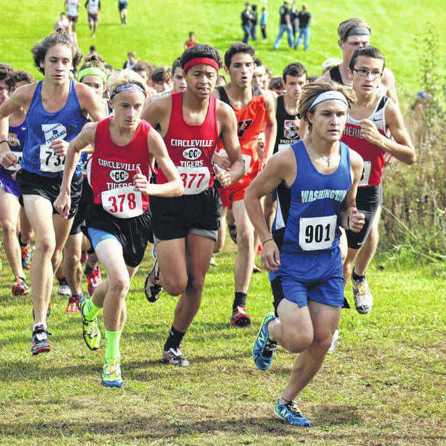 Washington High School junior Kameron Morris (wearing No. 901) climes a hill at the beginning of the Division II District cross country meet at Rio Grande Saturday, Oct. 21, 2017. Morris placed 14th overall out of 193 runners to advance to the Regional meet Saturday at Pickerington North High School.