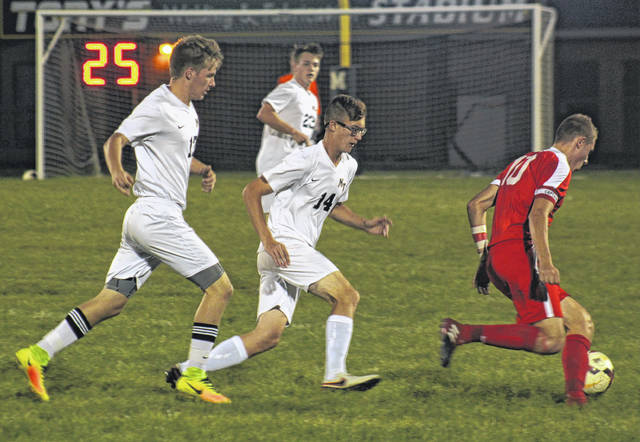 Miami Trace's Kody Burns (left) and Devin Howard (14) pursue a Jackson player during a Frontier Athletic Conference match Tuesday, Oct. 3, 2017 at Miami Trace High School. Also pictured for the Panthers is Christian Caldwell.