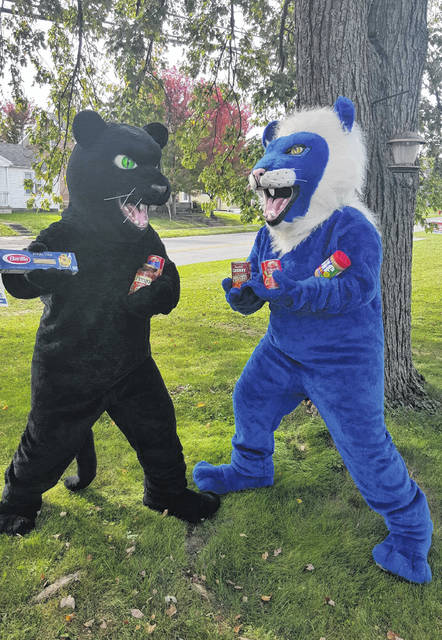 The Miami Trace Panthers mascot and the Washington Blue Lions mascot recently got together to promote this week's food drive to benefit The Bread of Life food pantry. The food drive competition between the districts will end at Friday's rivalry football game.