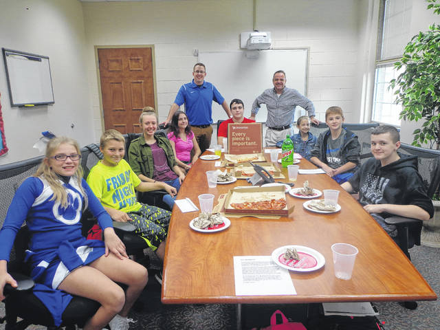 "Donatos recently provided pizza to these students at Washington Middle School as they celebrated ""Pizza with the Principals."" This is in appreciation for their selection as Students of the Month for September. They are chosen by their teachers because of the outstanding example they set for their peers in such areas as academic effort, good work ethic, kindness to others, and service to their school. Pictured (L to R): Lily Chamberlin, Connor Schoenfeld, Izzy Racine, Dishaya Hallmon, Mason Mustain, Lexi Allen, Trae Patton and Mason Cottrill."