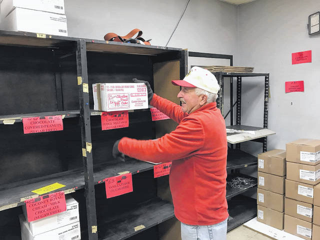 Good Hope Lion Jeff Fetters helped stock the shelves of the Good Hope Lions Candy Store on Thursday. The store will open for business on Wednesday, Nov. 15.