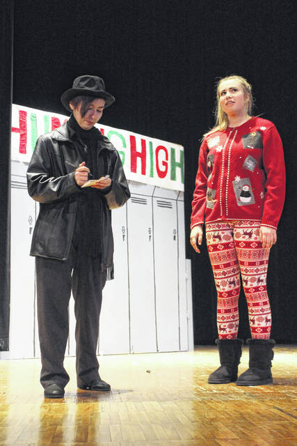 "The Miami Trace High School cast and crew of the upcoming production of ""Humbug High"" invite the community to join them as they re-imagine a classic holiday story. Pictured (L to R) is Sydni Ward and Khenadi Grubb at practice Wednesday afternoon."