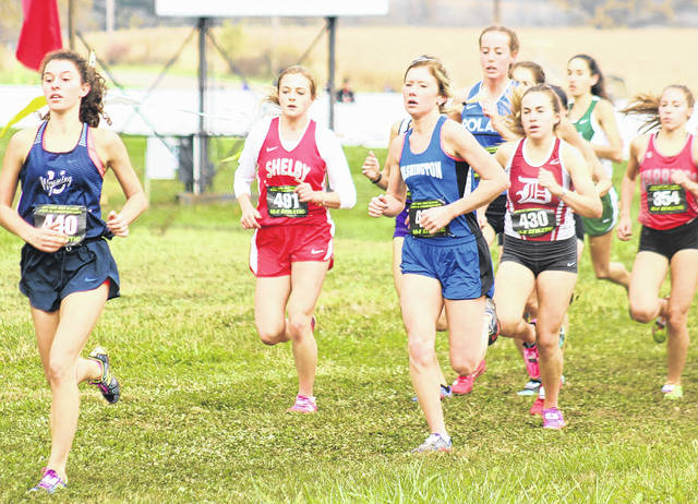 Washington High School senior Maddy Garrison (third from left) competes at the 40th annual State Division II girls cross country meet Saturday, Nov. 4, 2017 at National Trail Raceway near Hebron, Ohio.