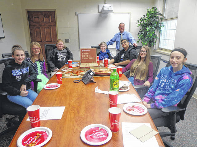 """Donatos recently provided pizza to these students at Washington Middle School as they celebrated """"Pizza with the Principals."""" This is in appreciation for their selection as Students of the Month for November. They are chosen by their teachers because of the outstanding example they set for their peers in such areas as academic effort, good work ethic, kindness to others, and service to their school. Pictured from left: Addison Shiltz, Arian Taylor, Casie Williams, John Wall, WMS assistant principal Mr. Montgomery, OM Patel, Nevaeh McNichols, Kaitlyn Coder, absent from picture- Tiara Erskine."""