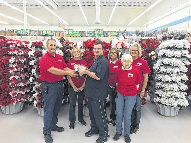 Pat Catan's: Matthew presenting a Give Back basket to Brett Joseph along with (front): Carol Wilson, and (back row) Terri Feary, Gloria Polley and Tracey Richards.