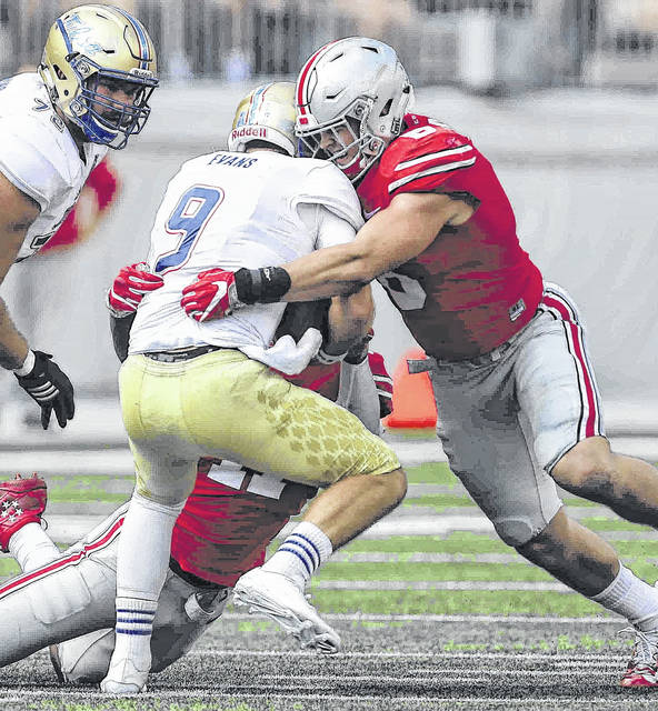 Ohio State's Sam Hubbard (6) and Jalyn Holmes (11) sack Tulsa quarterback Dane Evans last season in Ohio Stadium.