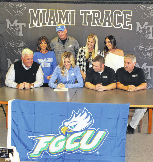 Tanner Bryant, seated, has signed a letter of intent to attend Florida Gulf Coast University in Fort Myers. She pictured with (seated, l-r); former Miami Trace head coach Mike Henry, current Miami Trace head coach Ben Ackley and assistant coach Randy Welsh; (standing, l-r); her parents, Kim and Mark and two of her sisters, Kasey and Bailey.
