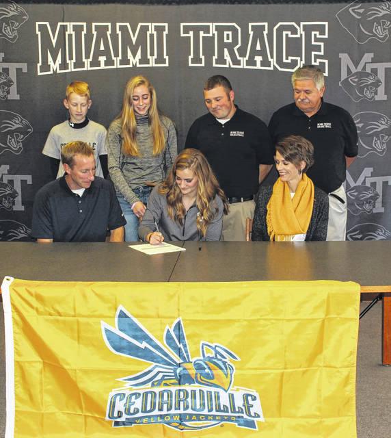 Miami Trace senior Victoria Fliehman (seated) is flanked by her parents, Tracy and Julie; (in back, l-r); brother Eli and sister Olivia, Miami Trace head coach Ben Ackley and assistant coach Randy Welsh.