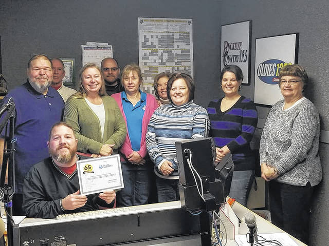 Pictured from left are Bryce Matson (seated), Harry Wright, Oscar Allen and Renee Skaggs all of WCHO Radio along with Chamber representatives Doug Saunders, Diane Amore, Ruth Ann Ruth, Whitney Gentry, Kristy Bowers and Barb Duncan.