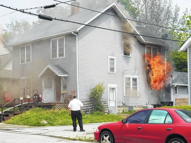 The Washington Fire Department responded to a house fire in May. The home at 212 Sycamore St. was showing smoke and fire poured from a window near the alleyway while firefighters worked to stop further damage.