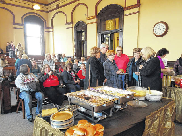 Fayette County Clerk of Courts Evelyn Pentzer (at right in black shirt) was surprised with a retirement party at the Courthouse on Friday morning. Visitors from all over the county attended to wish Pentzer the best in her retirement starting Jan. 1, 2018.