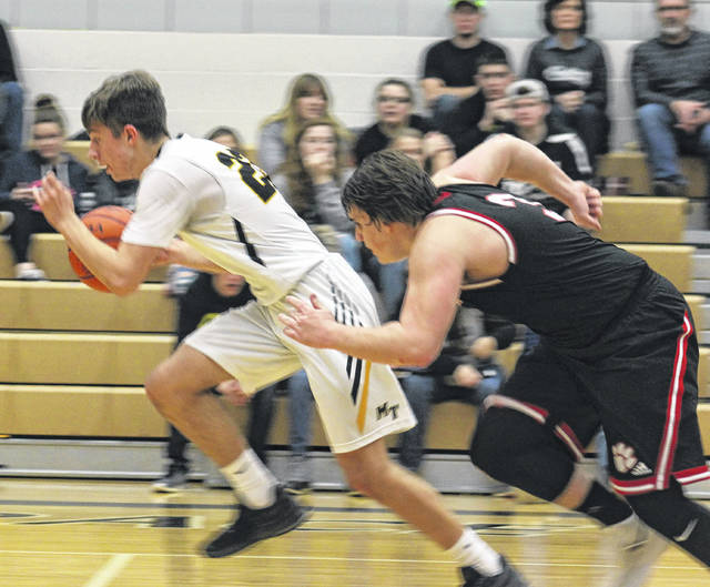 Miami Trace senior Brett Lewis heads up the floor after a steal during a non-conference game against Circleville Friday, Dec. 22, 2017 at the Panther Pit. Pictured for Circleville is senior Jake Mancini.