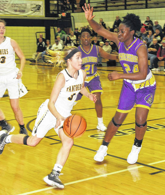 Miami Trace junior Cassidy Lovett drives against Reynoldsburg's Obianuju Ezeudu (24) during a non-conference game at the Panther Pit Saturday, Dec. 9, 2017. Also pictured for Reynoldsburg is Mackenzie Davis (21).