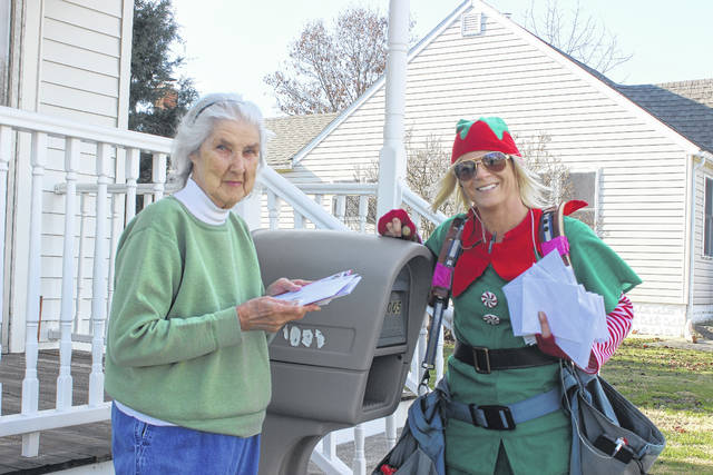 "Amanda, a ""secret elf"" with the U.S. Postal Service, was seen on Millwood Avenue Thursday delivering mail to Washington Court House resident Betty Hyer."