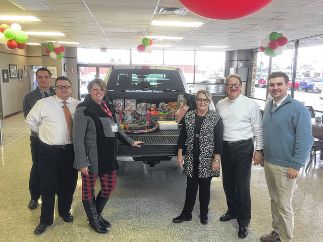 Beford Ford took up donations for Toys for Tots in Fayette County. Pictured from left to right, Tyler Rowe and JL White, Paula Campagna from Toys for Tots, Connie and Mark Beford, owners of Beford Ford, and Tim Hudson.