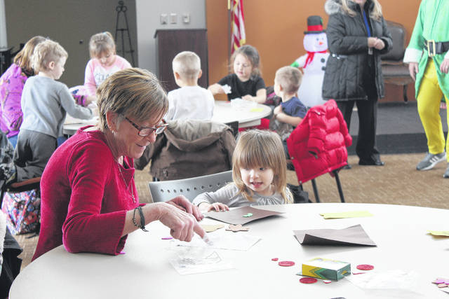"Fayette Progressive Schools, on Leesburg Avenue, gave students a ride on the ""Polar Express"" and a unique Christmas experience for both the morning and afternoon classes Tuesday. Pictured is Melissa and Carly enjoying the crafts during the event at Southern State Community College"
