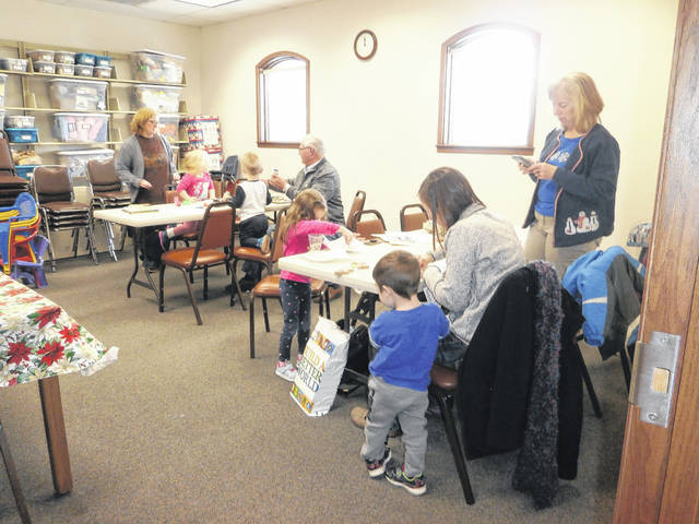 Miss Bonnie's Story Hour was jam-packed with activities recently at Jeffersonville Branch Library. Those participating heard Christmas stories, created penguin ornaments, angels, played instruments and last but not least created beautiful Christmas cookies.