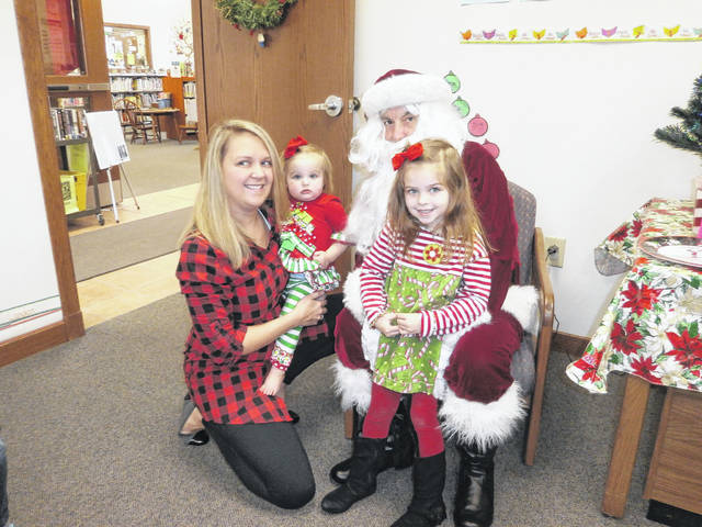 "Jeffersonville Branch Library was the place to be for Miss Bonnie's Story Hour which had a special guest from the North Pole. Santa Claus came and listened to all the good boys and girls' wishes for Christmas as well as listened to a neat story book, ""Must Be Santa""."