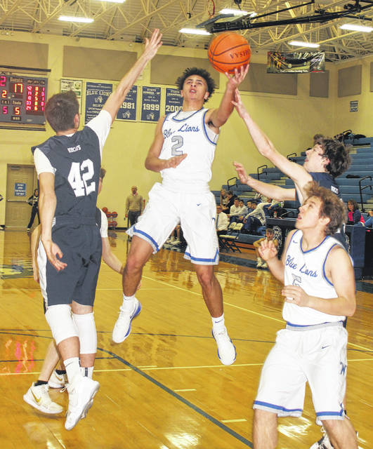 Washington junior Dillon Steward (2) puts up a shot during a non-conference game against Grandview Heights Saturday, Jan. 27, 2018 at Washington High School. Also pictured for Washington is sophomore Miguel O'Flaherty.