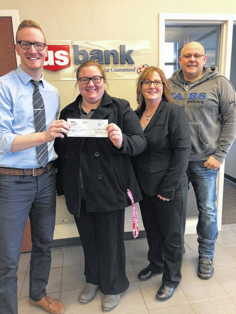 US Bank in Washington Court House recently donated $3,000 to Fayette County Habitat for Humanity. Pictured are Emily Wolfe, and Teresa and Brian Rowe. Habitat for Humanity is a non-profit housing organization working locally and in nearly 1,400 communities across the United States and in approximately 70 countries around the world. Habitat's vision is of a world where everyone has a decent place to live.