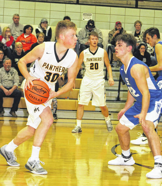 Miami Trace senior Heath Cockerill sets to pass from the point during a non-conference game against the Southeastern Panthers Saturday, Jan. 20, 2018 at the Panther Pit. Also pictured for Miami Trace is senior Dakota Bolton.