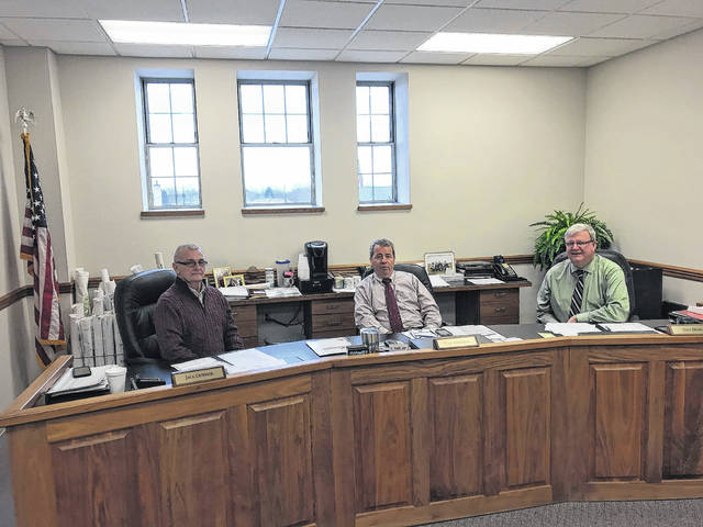 Tony Anderson (middle) will serve as the chairman of the Fayette County Commissioners in 2018. Anderson and county commissioners Jack DeWeese (left) and Dan Dean (right) held a meeting Monday.