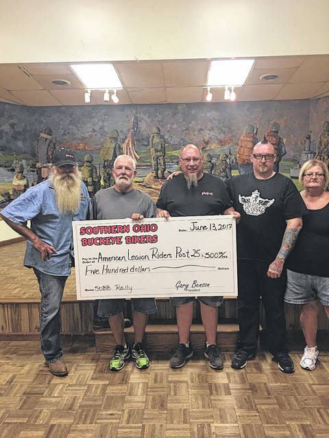 "The Southern Ohio Buckeye Bikers donated a check for $500 to the American Legion Riders Post 25 last year to be used to assist local veterans. The riders decided to use the money to refurbish a wheelchair that had been donated. Pictured (L to R): Jimmy ""Chicken Man"" Morrison, Brian Finney, Gary Benson, DJ Jenkins and Sandy Rodgers."