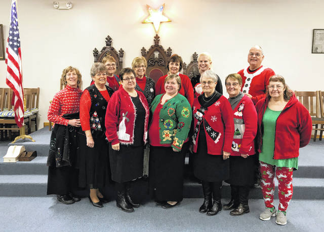 Members of Jefferson Chapter #300 Order of the Eastern Star wearing their favorite Christmas sweaters at their Dec. 19 meeting.