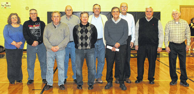 Members of the 1966-67 and 1968-69 Miami Trace basketball teams that went undefeated in the South Central Ohio League were on hand Saturday at the Miami Trace Middle School as the Panthers paid tribute to the first two Gold Basketball-winning squads in the school's history. (front, l-r); from the 1968-69 team, Steve Huffman, Dale Reno and Tom Gifford; (back, l-r); representing their father, head coach Delmar Mowery, Karen Mowery Evans and Steve Mowery and, from the 1966-67 team, Jay Cottrill, assistant coach John Bernard, David Bihl, Mike Henry and Dan Hoppes.