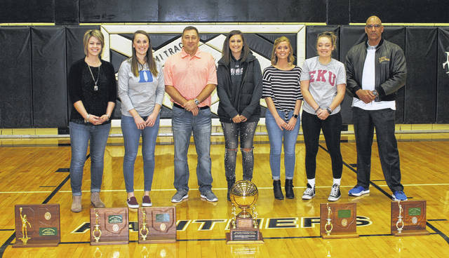 Miami Trace honored four basketball teams from the first decade of the 21st century at halftime of the Lady Panthers' game against Ottawa-Glandorf Saturday, Jan. 20, 2018. (l-r); Stephanie Stinson Davey, Kristin Reisinger, James Stutzman (head coach), Samantha Leach, Taylor Smith, Ashley Lawson and Mychal Turner (assistant coach).