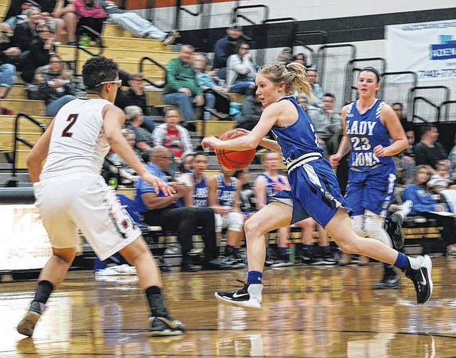 Washington senior Maddy Garrison brings the ball up the court during a non-conference game at Waverly High School Monday, Jan. 22, 2018. Also pictured for Washington is sophomore Shawna Conger.
