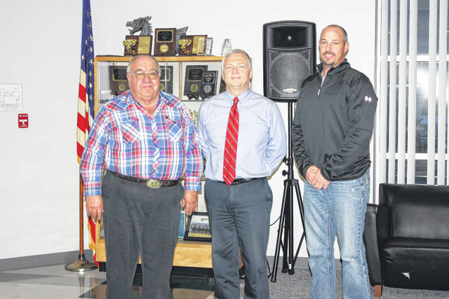 Larry Mayer (left) and Cody Kirkpatrick (right) were recently reappointed to the Fayette County Board of Developmental Disabilities by Judge David Bender (middle).