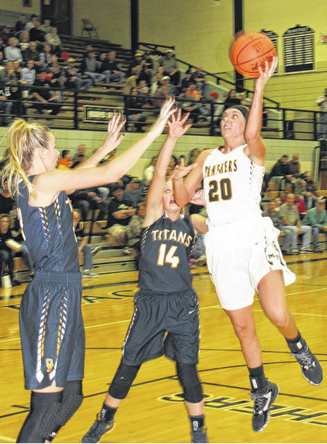 Miami Trace senior Tanner Bryant puts up a shot with her left hand against Ottawa-Glandorf Saturday, Jan. 20, 2018 at the Panther Pit. No. 14 for O-G is Erin Kaufman.