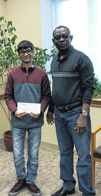 Nishil Shah (left) was also awarded a scholarship for the field of engineering. He is pictured with Godwin Apaliyah, director of Fayette County Economic Development.