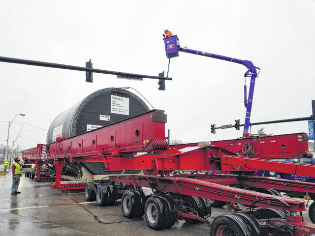 A giant trailer carrying a large dryer that will be utilized at a new 1.4 million-square-foot tissue plant in Pickaway County traveled through Washington Court House Wednesday afternoon. As the convoy made its turn in front of Kroger, vehicles were cleared and traffic lights were adjusted to help the large load smoothly traverse through the city.