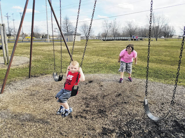 "With warm temperatures and sunshine Tuesday, Hunter and Halie Bryant, great-grandkids of Clarence Christman, spent the afternoon with their aunt ""Mi Mi"" (Christman's granddaughter) learning about their great-grandfather and playing at the park dedicated to him."