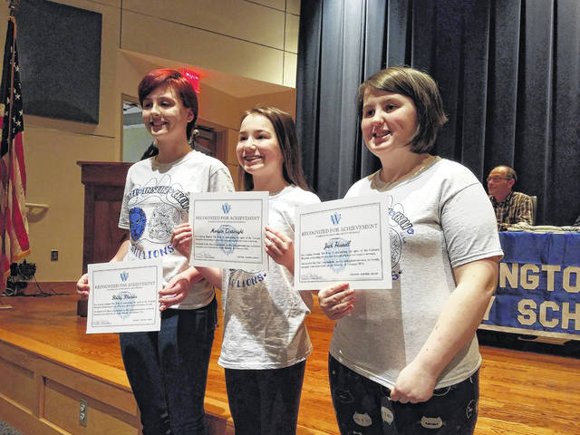 """Jack Hussell, Morgan Cartwright and Bailey Rhoades, three Washington Middle School artists, were also honored for their work on the """"Restore the Roar"""" campaign T-shirts."""