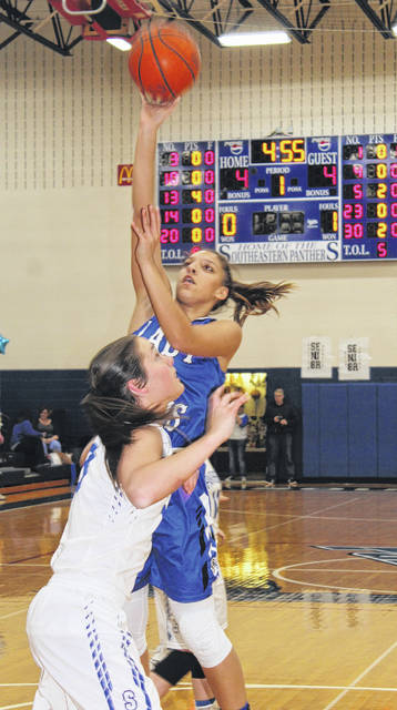 Washington junior Hannah Haithcock shoots over Southeastern senior Ella Skeens during a match-up of two teams with records of 18-2 Tuesday, Feb. 6, 2018 at the Larry Jordan gymnasium at Southeastern High School.