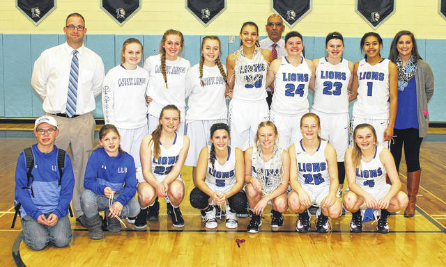 The Washington Lady Blue Lions won a Sectional championship by defeating Unioto, 54-51 Saturday, Feb. 17, 2018 at Adena High School. (front, l-r); Joey Pickleheimer, videographer, Karris Dye, Halli Wall, Kassidy Hines, Maddy Garrison, Tabby Woods, Bre Taylor; (back, l-r); j-v coach Corey Dye, Abby Tackage, Cloe Copas, Mallory Hicks, Hannah Haithcock, assistant coach Mychal Turner, Maddy Jenkins, Shawna Conger, Rayana Burns and head coach Samantha Leach.