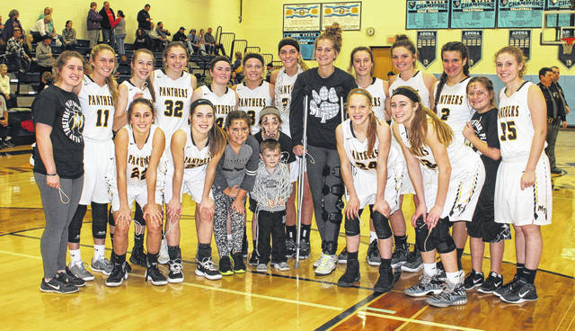 The Miami Trace Lady Panthers on the floor at Adena High School near Frankfort after winning a Sectional championship over Circleville, 40-29 Saturday, Feb. 17, 2018. (front, l-r); Reagan Barton, Gracee Stewart, Lawshin Grooms, Gracie Lovett, Ollie Barker, Magarah Bloom, Olivia Fliehman; (back, l-r); Aubrey Schwartz, Tori Evans, Aubrey McCoy, Krissy Ison, Becca Ratliff, Cassidy Lovett, Tanner Bryant, Victoria Fliehman, Shay McDonald, Morgan Miller, Olivia Wolffe, Zoey Grooms and Grace Bapst. Not pictured: Lena Steele and coaches Kayla Overstake, Randy Welsh, Randy Rodgers, Shawn Grooms and Ben Ackley.