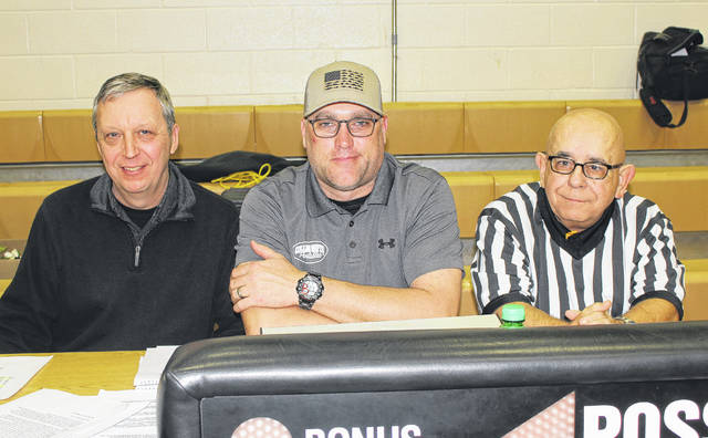 These three men have been working the scorer's table at Miami Trace boys basketball games for many years, none more than the man at far right. (l-r); Dick Glass, public address announcer, Bruce Collins, scoreboard operator and Tom 'Chatter' Harris, scorebook keeper, pictured at the final home boys basketball game in the Panther Pit Friday, Feb. 2, 2018.