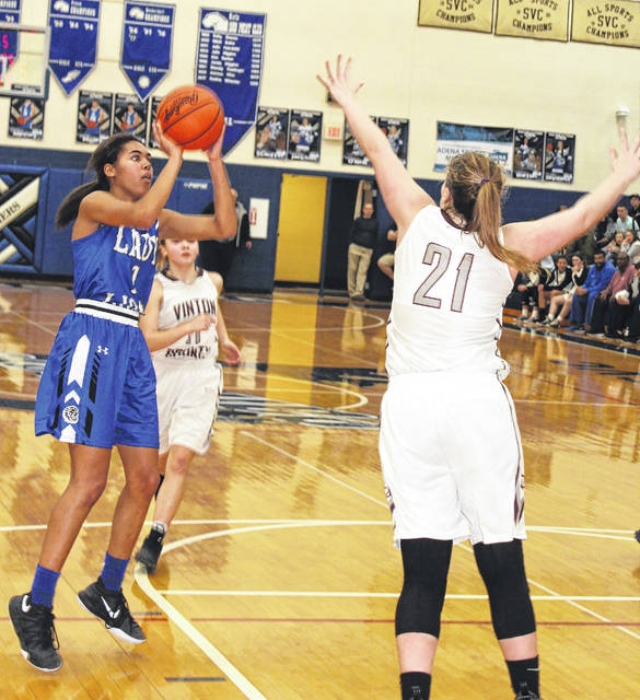Washington sophomore Rayana Burns puts up a shot against Vinton County in a Division II District semifinal game Thursday, Feb. 22, 2018 at Southeastern High School. Pictured for Vinton County is freshman Morgan Bentley (21).