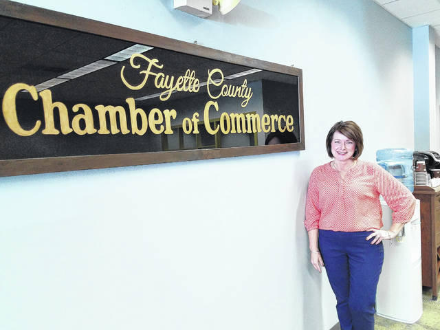 The new president for the Fayette County Chamber of Commerce, Julie Bolender, started work Monday by visiting the county commissioners and Washington Court House City Manager Joe Denen.