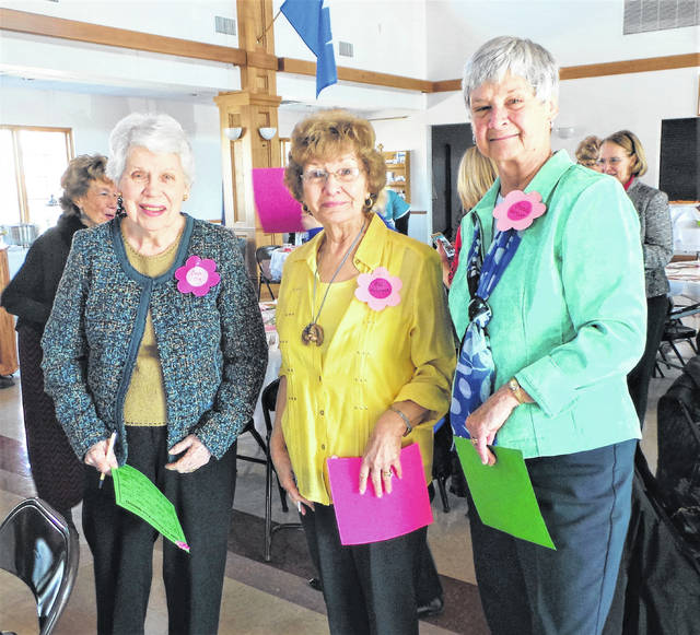 Three retired teachers become re-acquainted prior to the joint Delta Kappa Gamma spring luncheon. In the foreground are (from left) Faye Coe, a member for more than 50 years in Chillicothe's Alpha Gamma chapter; and Miami Trace Schools' Sue Anderson and Brenda Warner, who between the two of them can claim exactly 50 years of membership in Fayette County's Alpha Delta chapter. Just visible in the background are Washington City Schools' Cindy Sagar (on the far left) and Diana Kirkpatrick (on the far right).